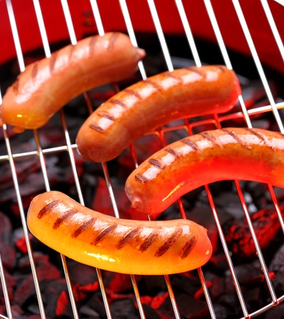 sizzle: Hot sausages on barbecue