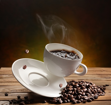 Falling coffee cup on the table Stock Photo - 9737747