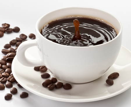 drop falling into a cup of coffee photo