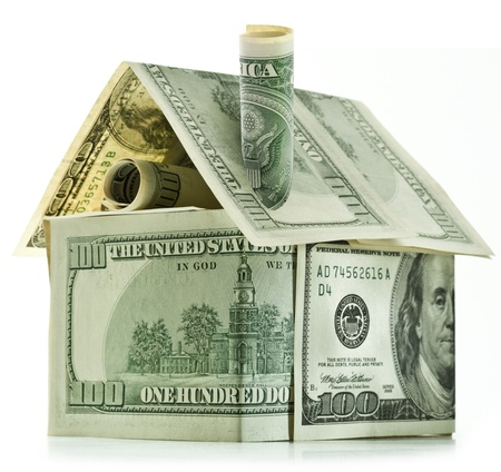 cash money: Dollar house isolated over white.