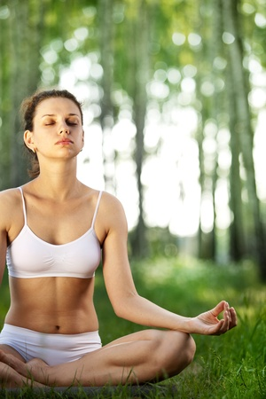Practicing of yoga outdoors. Stock Photo - 9784023