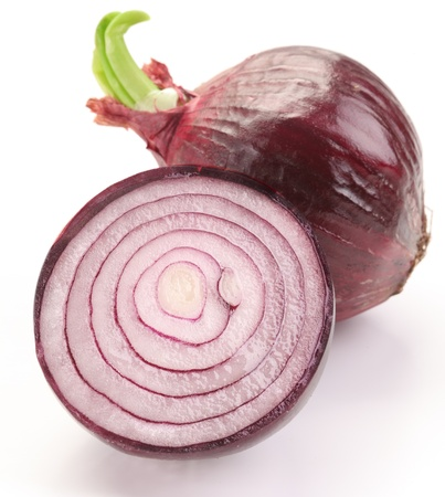 onions: Bulbs of red onion with green leaves on a white background. Stock Photo