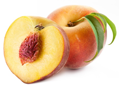 Appetizing peaches with leaves. Isolated on a white background. photo