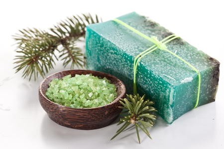 Pine soap with sea-salt and branch of pine. photo