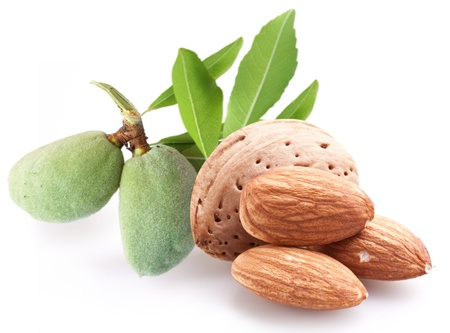 hard core: Group of almond nuts with leaves. Isolated on a white background.