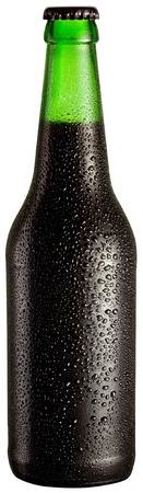 dewed: Bottle of black beer with drops on white background. The file contains a path to cut.