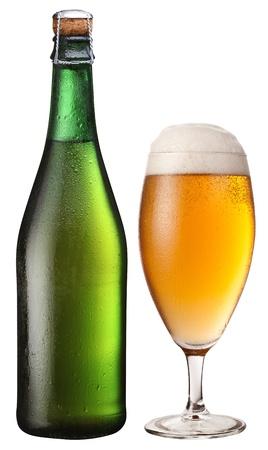 glass bottles: Glass and bottle of light beer.  Stock Photo