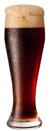 Frosty glass of black beer isolated on a white background.  photo