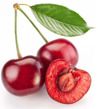 halves: Two cherries and half of cherry isolated on a white background.