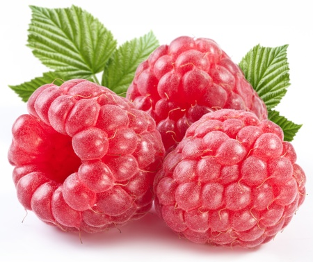 Three perfect ripe raspberries with leaves. Isolated on a white background. 스톡 콘텐츠