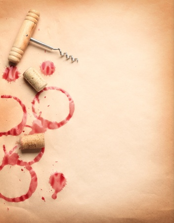 corkscrew: Wine circles from the bottle on old paper with a corkscrew and stoppers. Stock Photo