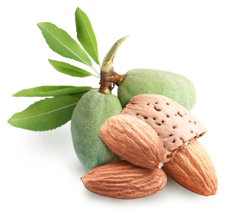 Group of almond nuts with leaves. Isolated on a white background.