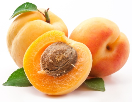 clean cut: Apricots with leaves on a white background. Stock Photo