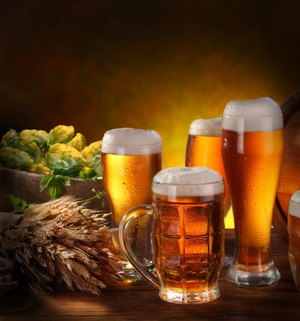 draft beer: Still Life with a keg of beer and draft beer by the glass. Stock Photo