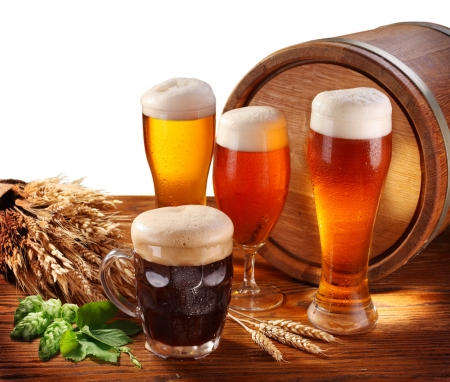 unbottled: Still Life with a keg of beer and draft beer by the glass. Isolated on a white. Stock Photo