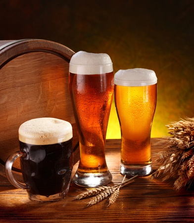 mug of ale: Still Life with a keg of beer and draft beer by the glass. Stock Photo