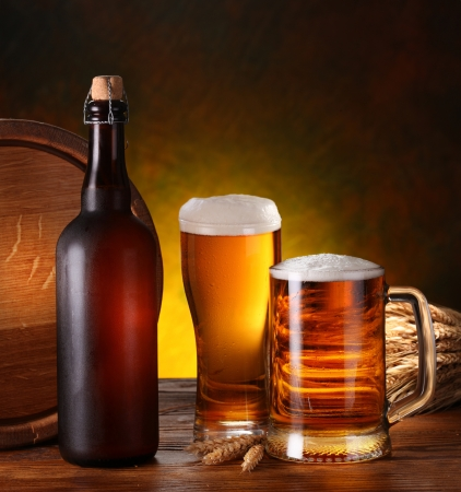 brewing: Still Life with a keg of beer and draft beer by the glass. Stock Photo