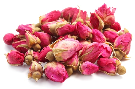 dried up: Heap of tea roses isolated on a white background.