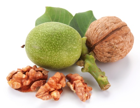 Green walnut; peeled walnut and its kernels. Isolated on a white background. Stock Photo