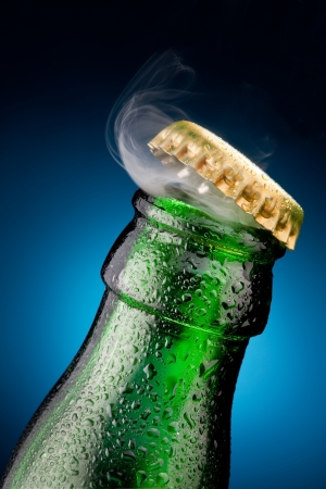 glass beer bottle: Opening of beer cap with the gas output Stock Photo