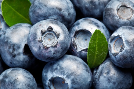 entire: Blueberries with leaves occupies the entire frame area.