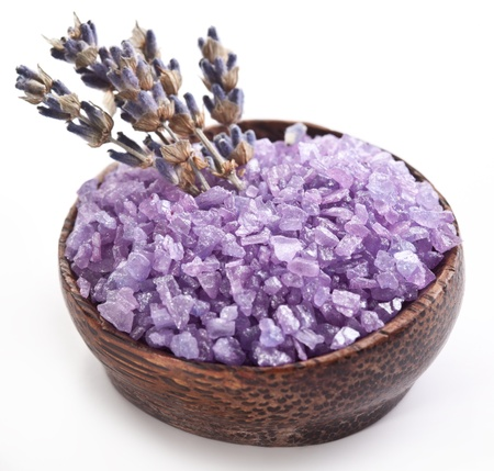 bath salt: Sea-salt and dried lavender on a white background.