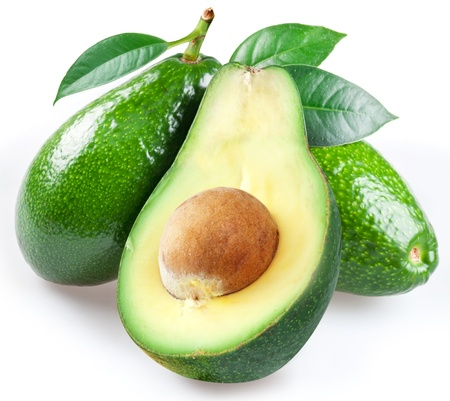 avocado: Ripe avacados with leaves on a white background.
