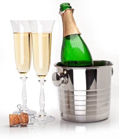 cristmas: Champagne bottle in cooler and two champagne glasses. Isolated on a white.