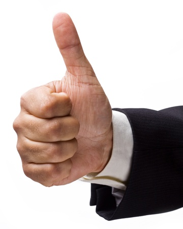 Businessmans hand showing the seal of approval. photo