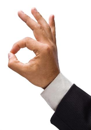 comunicacion no verbal: Hombre de negocios de la mano que muestra signo de OK. Foto de archivo