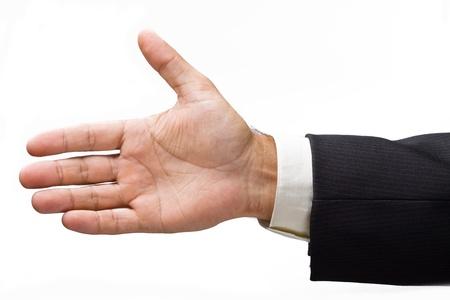 comunicacion no verbal: Hombre de negocios extendido la mano para un apret�n de manos. Aislado en un fondo blanco. Foto de archivo