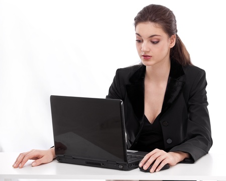 indian style sitting: Girl working with laptop. Picture on a white background.