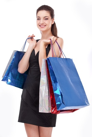 Smiling girl with shopping bags. Isolated on a white background. photo