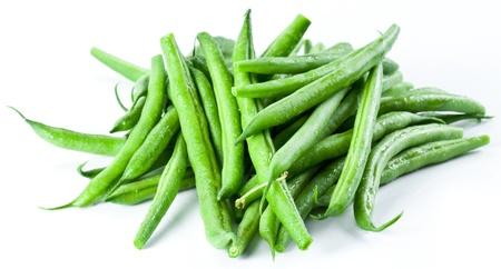 frijoles: Jud�as verdes aisladas sobre un fondo blanco. Foto de archivo