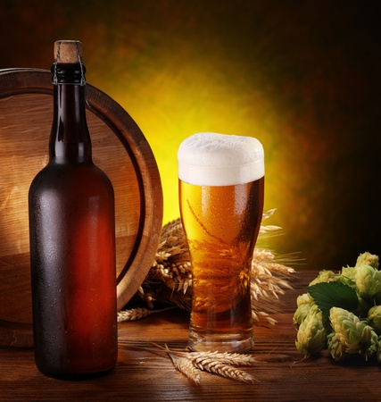 beer bottle: Still life with beer, wheat and hops. Stock Photo