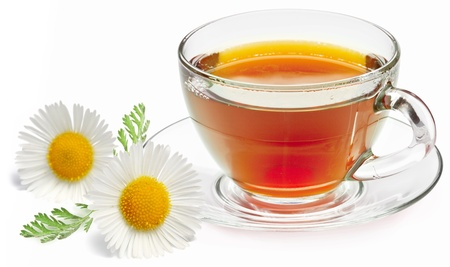 Chamomile tea on a white background. photo