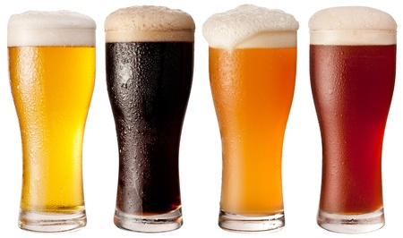 Four glasses with different beers on a white background. The file contains a path to cut. Stock Photo