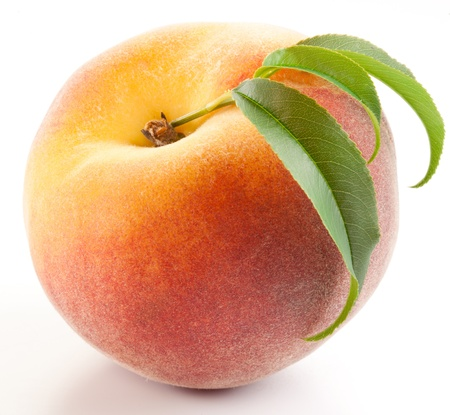 the peach: Ripe peach with leaves isolated on a white background.
