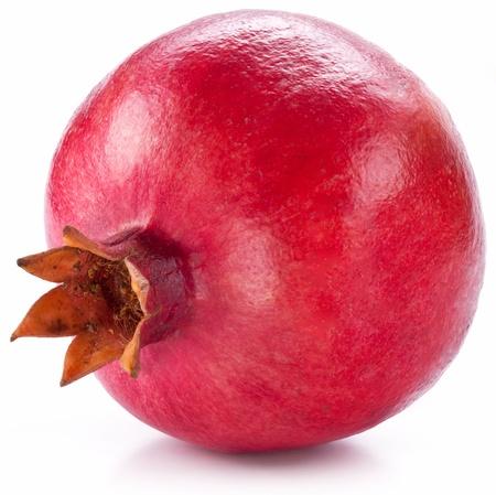 grenadine: Ripe pomegranate isolated on a white background.