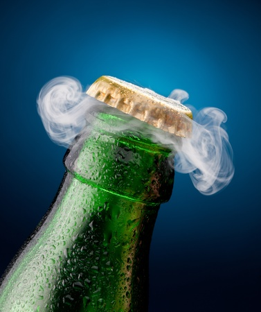 cold beer: Opening of beer cap with the gas output