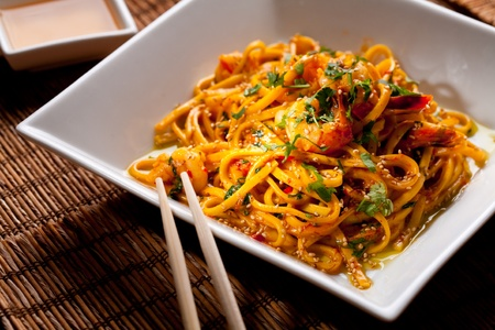 Chinese noodles with shrimps on a bamboo table photo