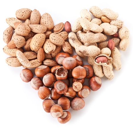 filbert nut: Nuts in the shape of heart isolated on a white background.