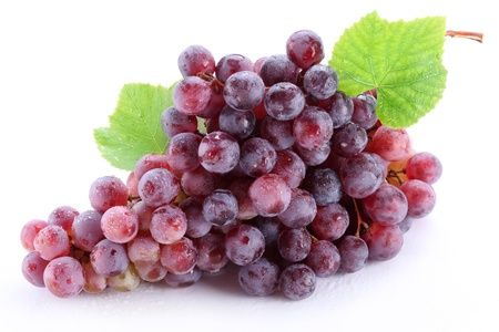 Grape cluster with leaves isolated on a white background photo