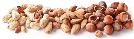 unbroken: Group mixed nuts. Macro shot on white background.