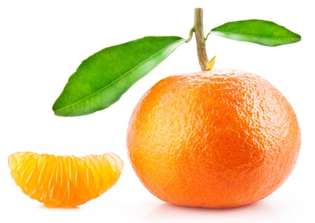 Tangerine with leaves and its slice on white background. photo