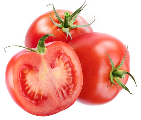 Two tomato with a slice on a white background. Stock Photo