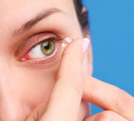 eyelid: human eye with corrective lens on a blue background  Stock Photo
