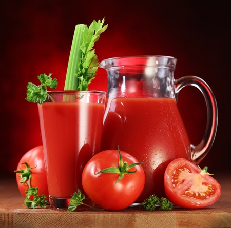 carafe: Still life  tomatoes, jug and glass full of fresh tomatoes juice on wooden table