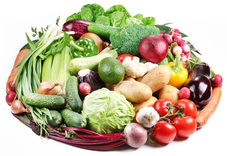 Variety of vegetables are laid out in a circle on a white background  photo