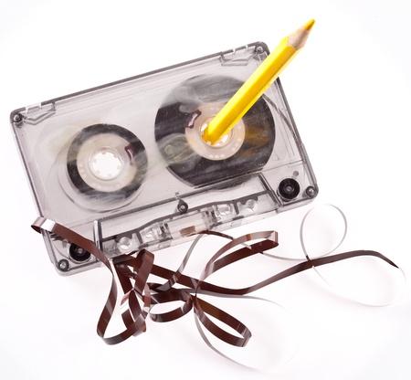 tape recorder: Antiguo cartucho roto aislado en blanco Foto de archivo